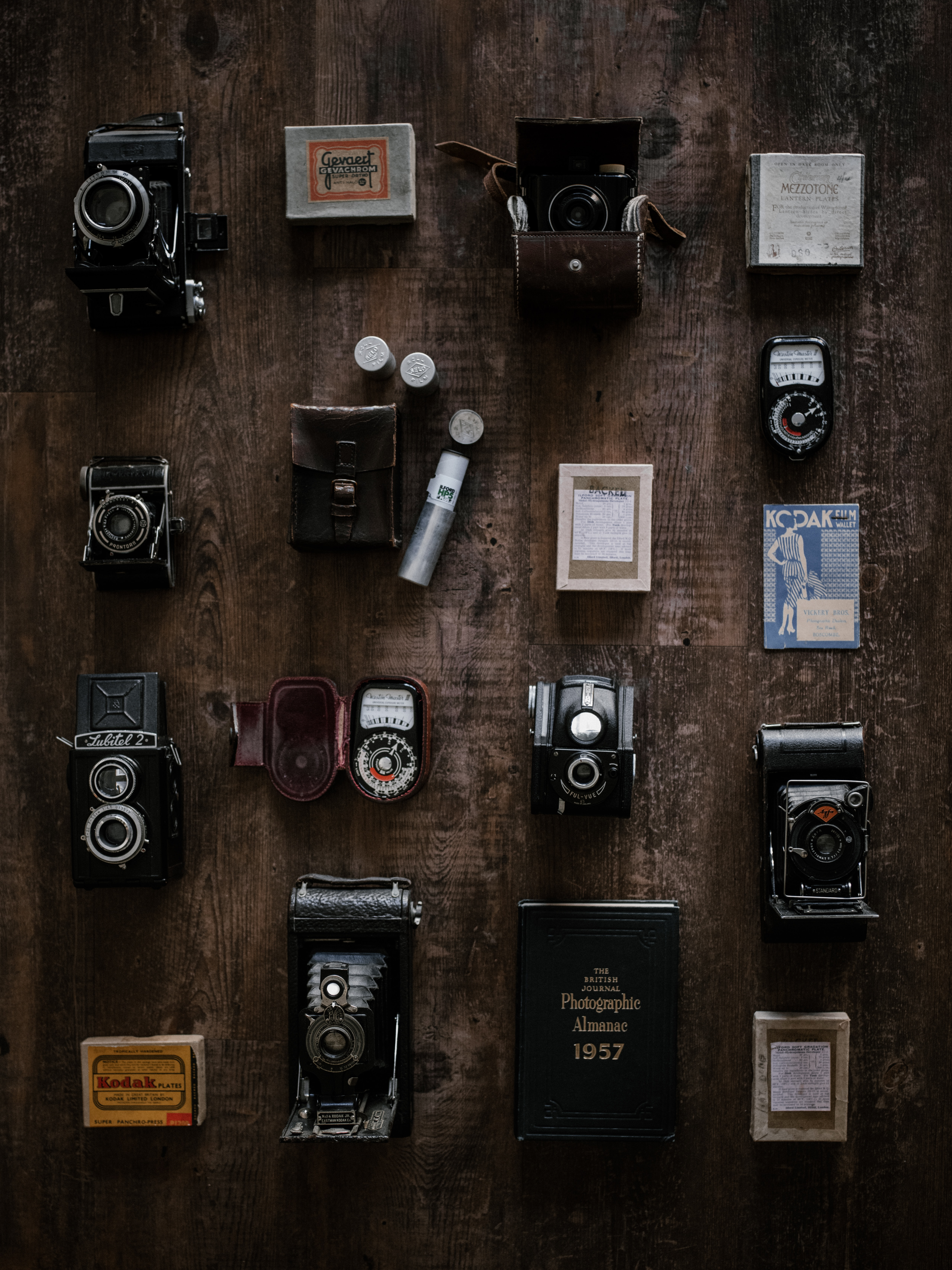 flat lay photography of assorted DSLR cameras