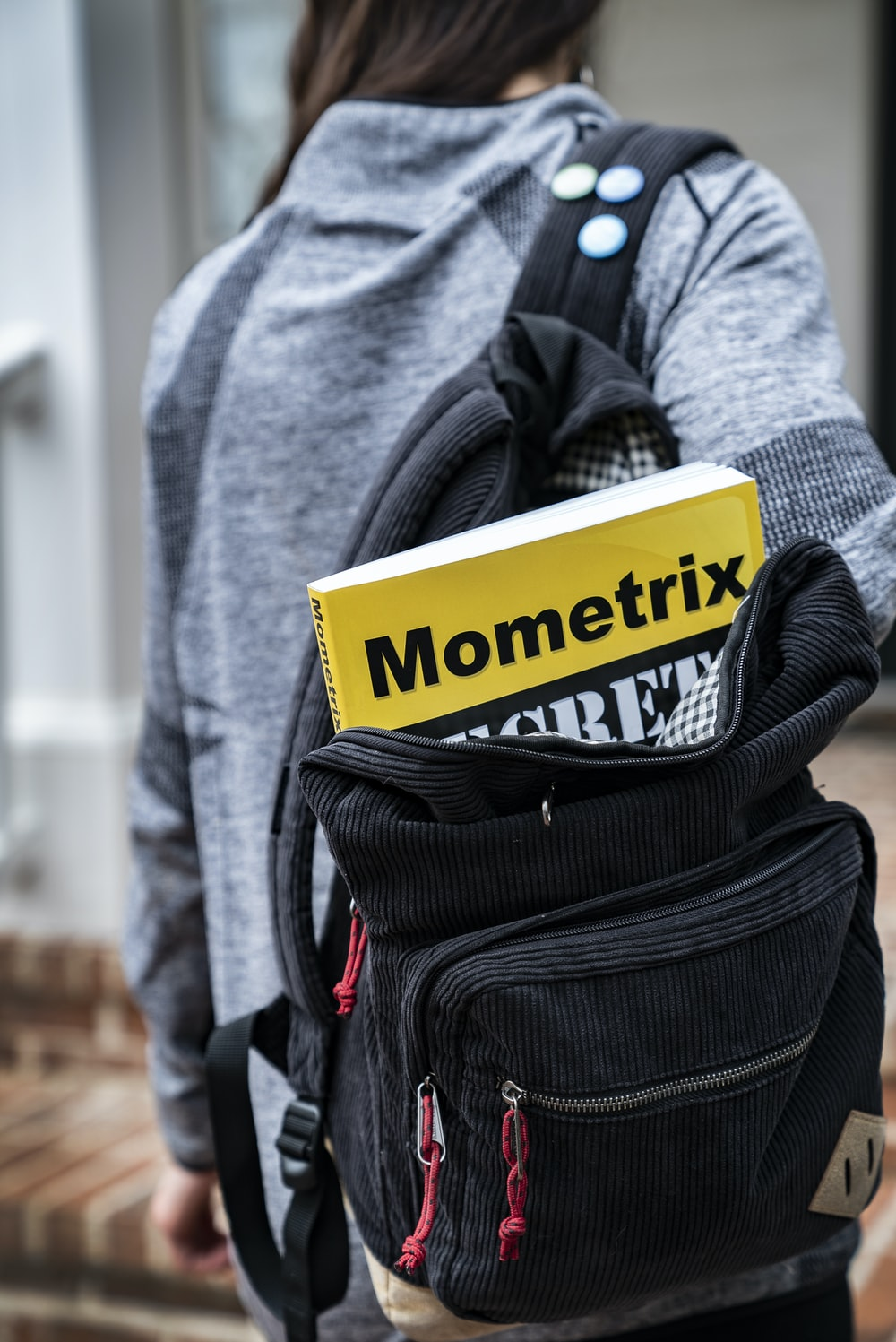 Mometrix book inside black backpack