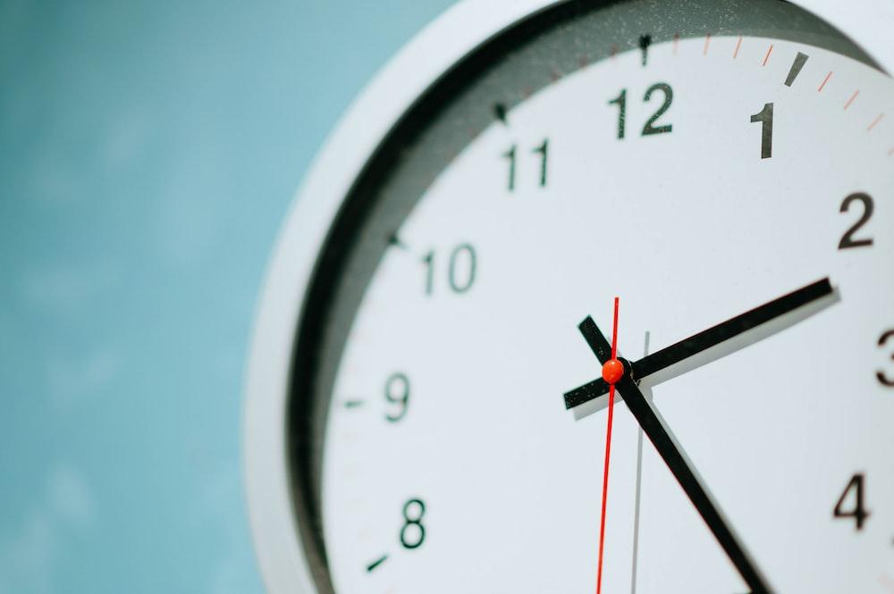 white round wall clock at 2:25