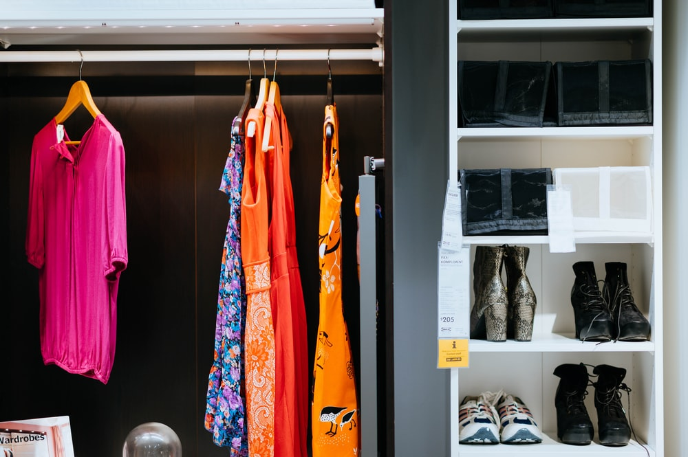clothes and shoes inside wardrobe