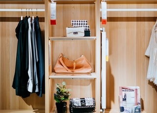 brown leather bag in shelf