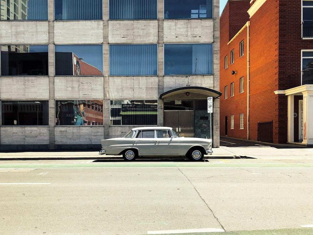 silver sedan on concrete road
