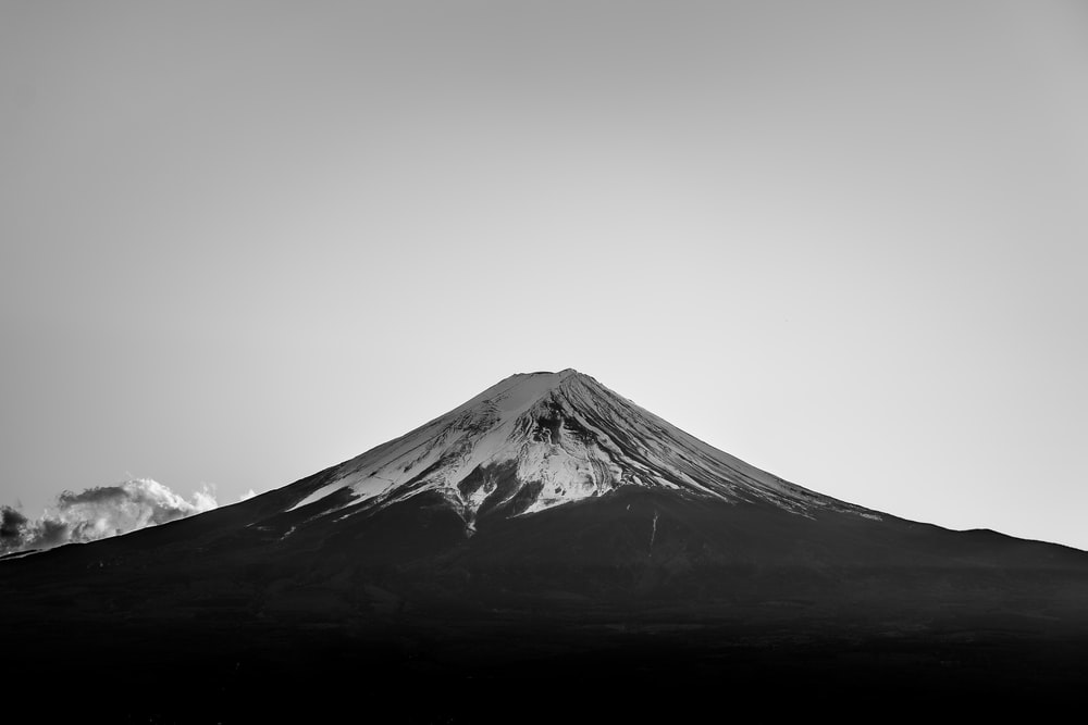 snow covered top mountain on grayscale photo