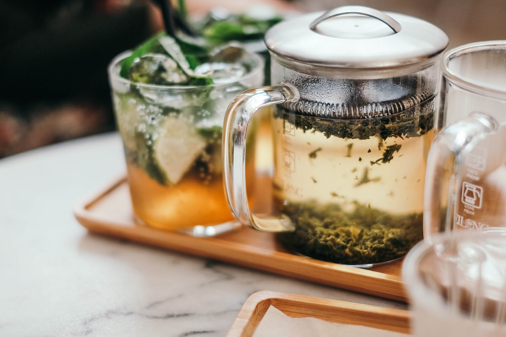 clear glass mug on tray