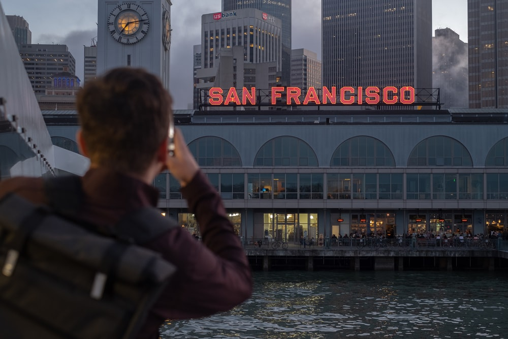 man looking at San Francisco signage