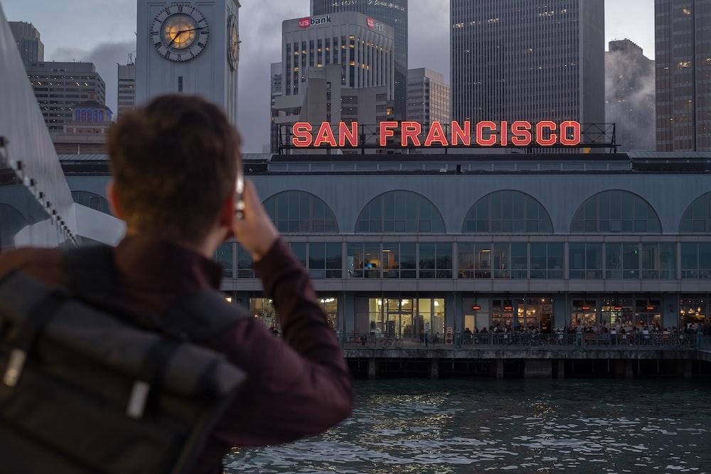 man looking at San Francisco signage