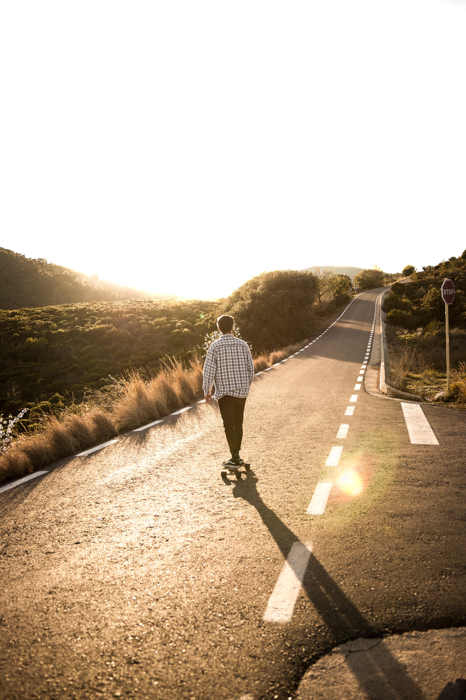 man skateboard on highway