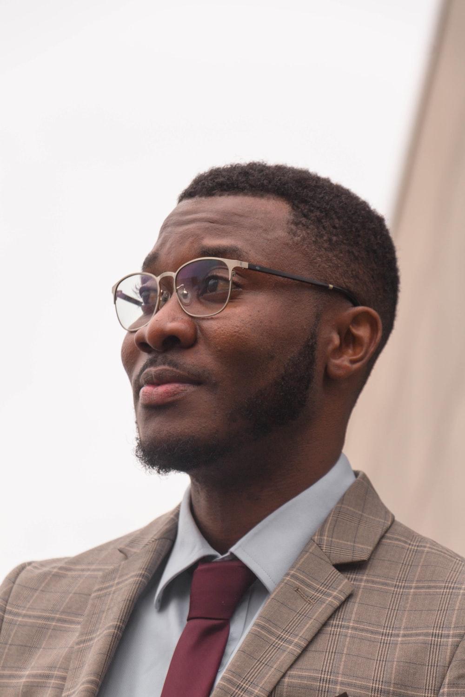 man wearing brown blazer