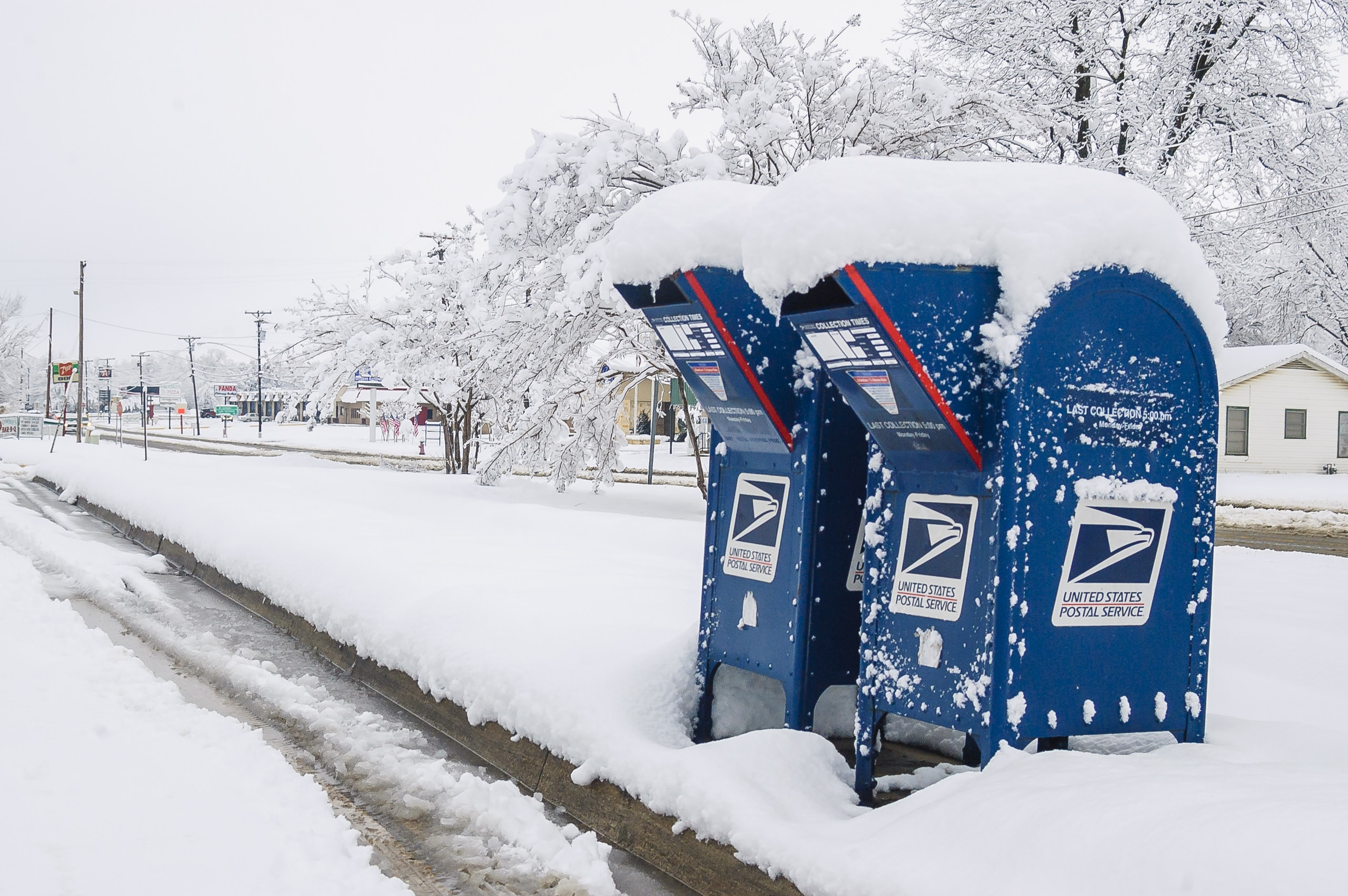 two blue-and-white mail boxes