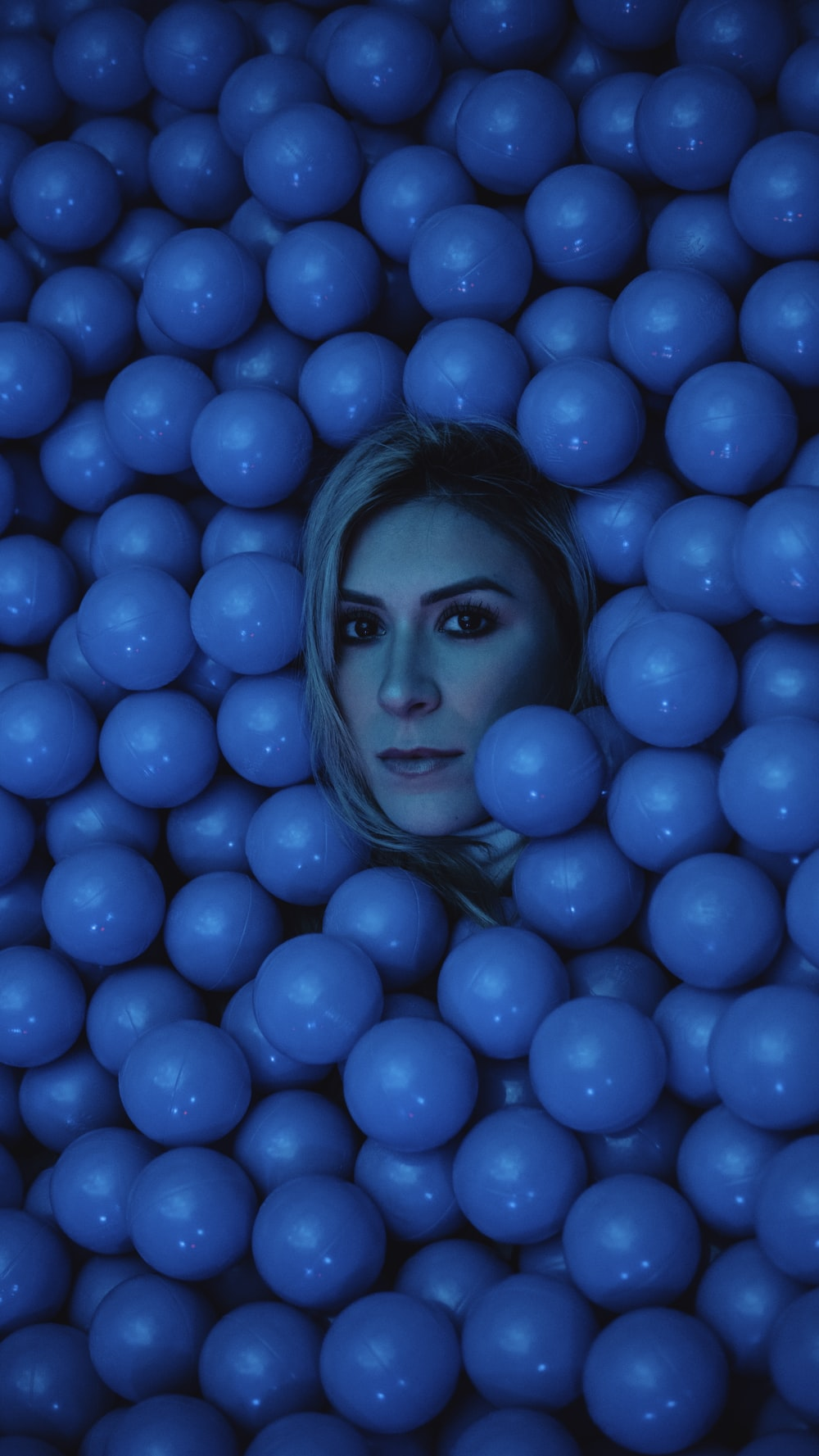 woman's face surrounded by blue balls
