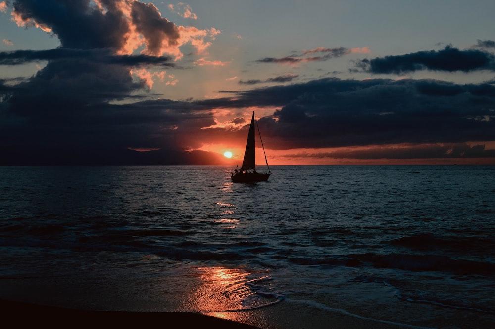 silhouette of sailboat on sea