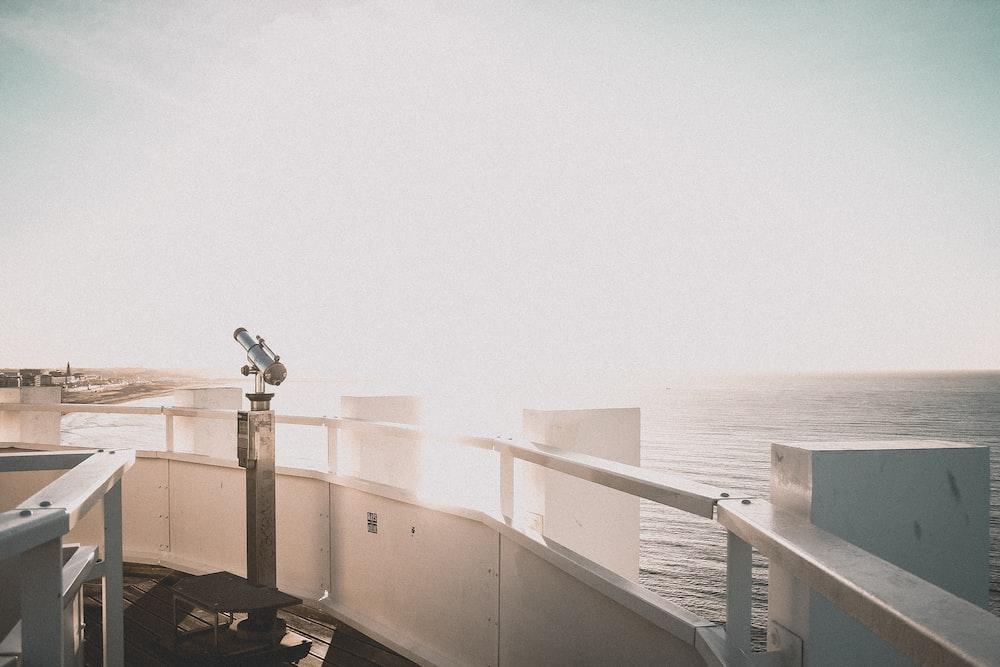 telescope overlooking sea