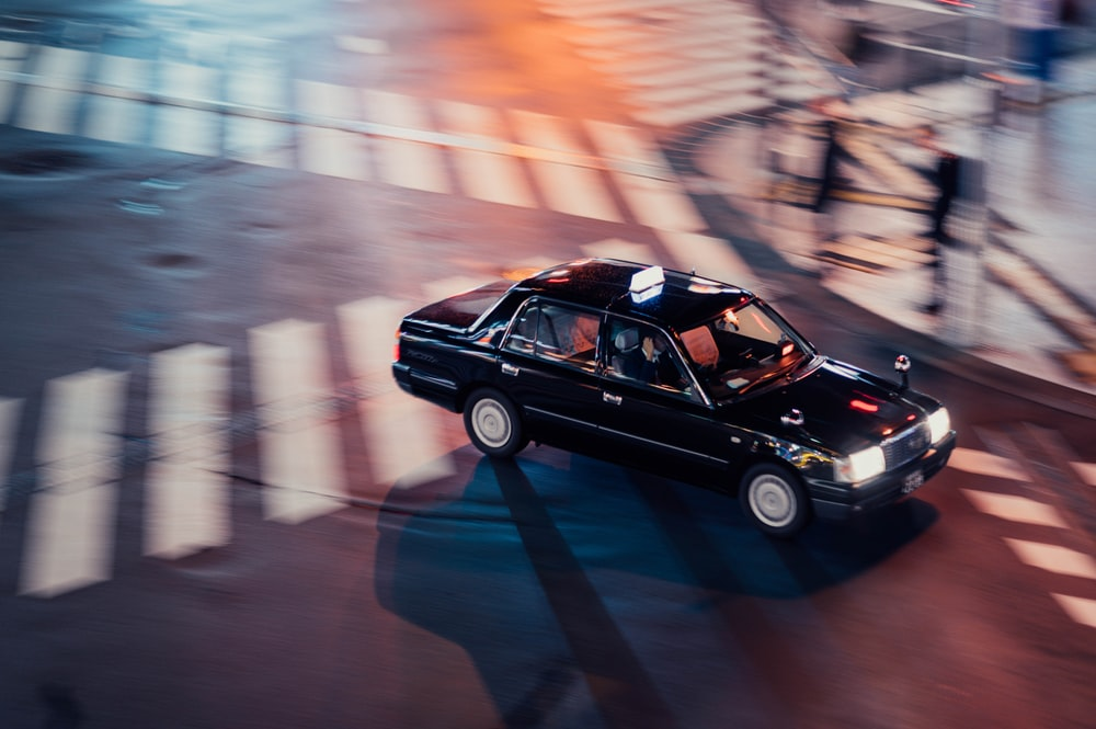 black car passing througn