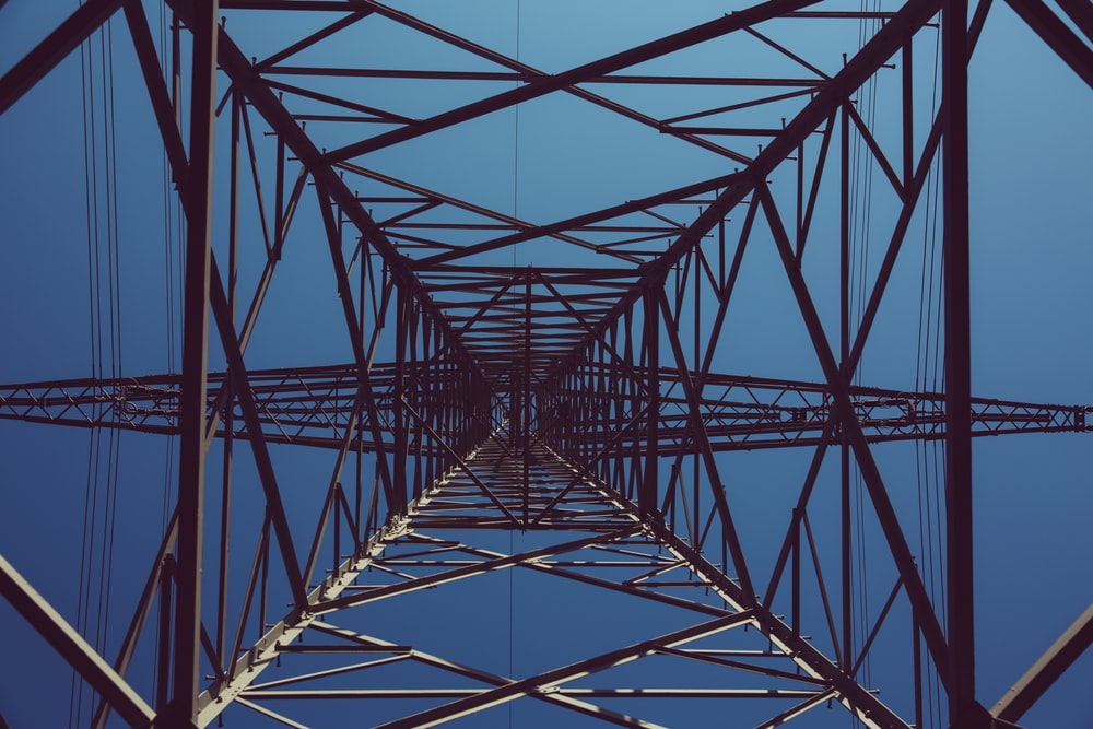low angle photography of black transmission tower