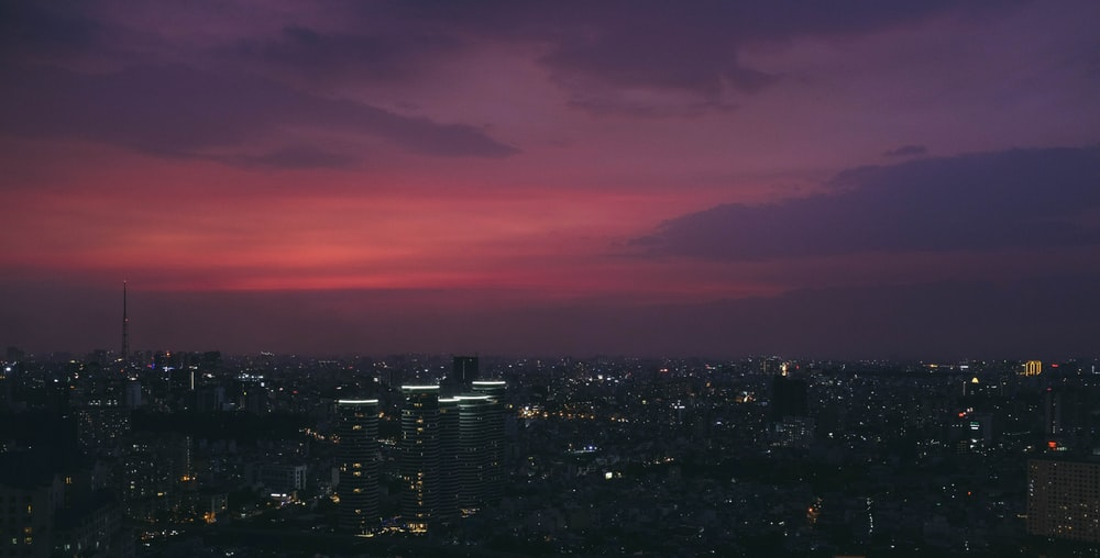 cityscape under purple sky