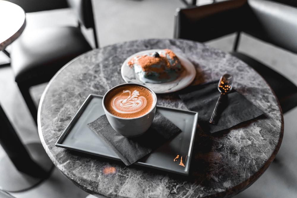 blue ceramic teacup on table