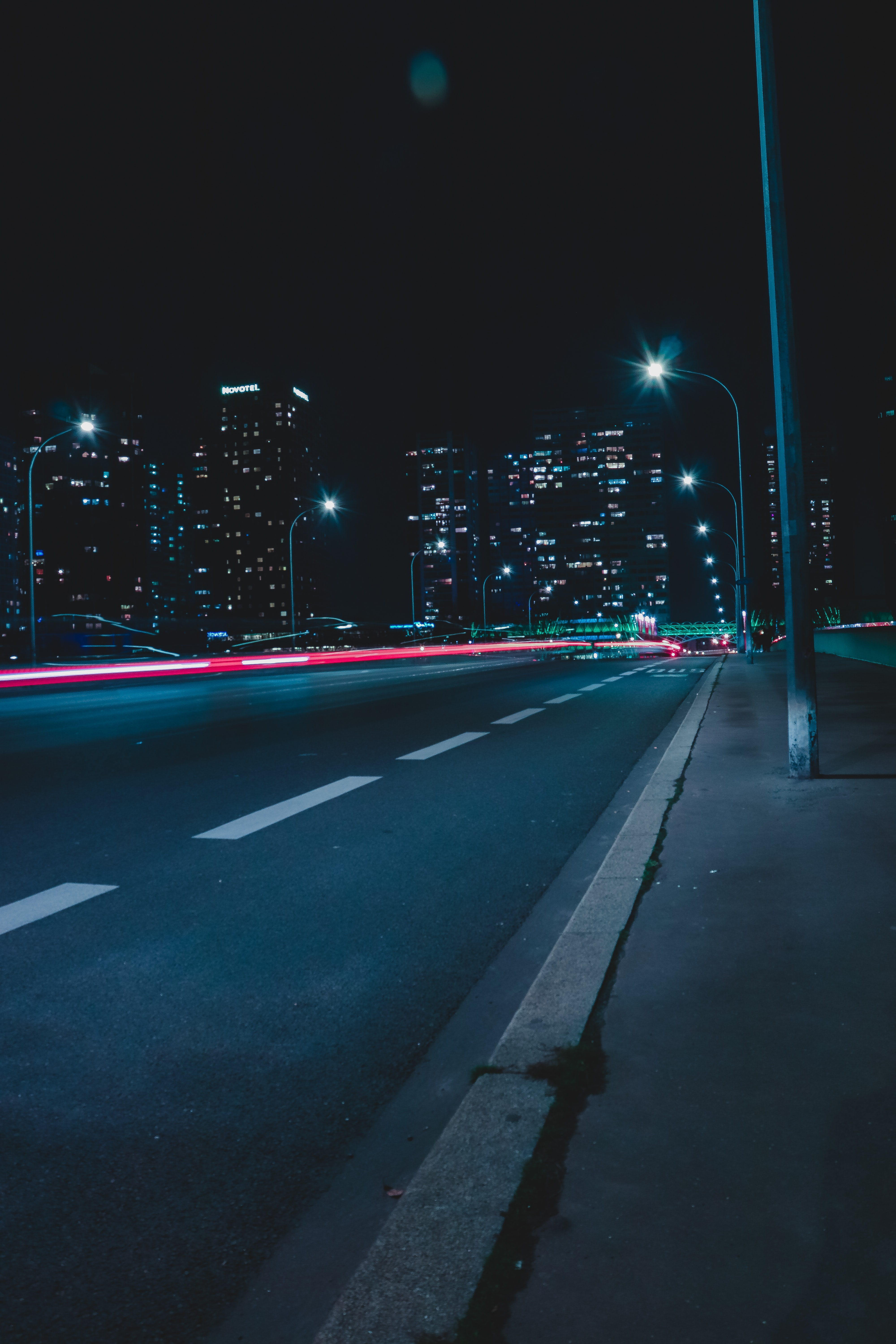empty street with lights during nighttime