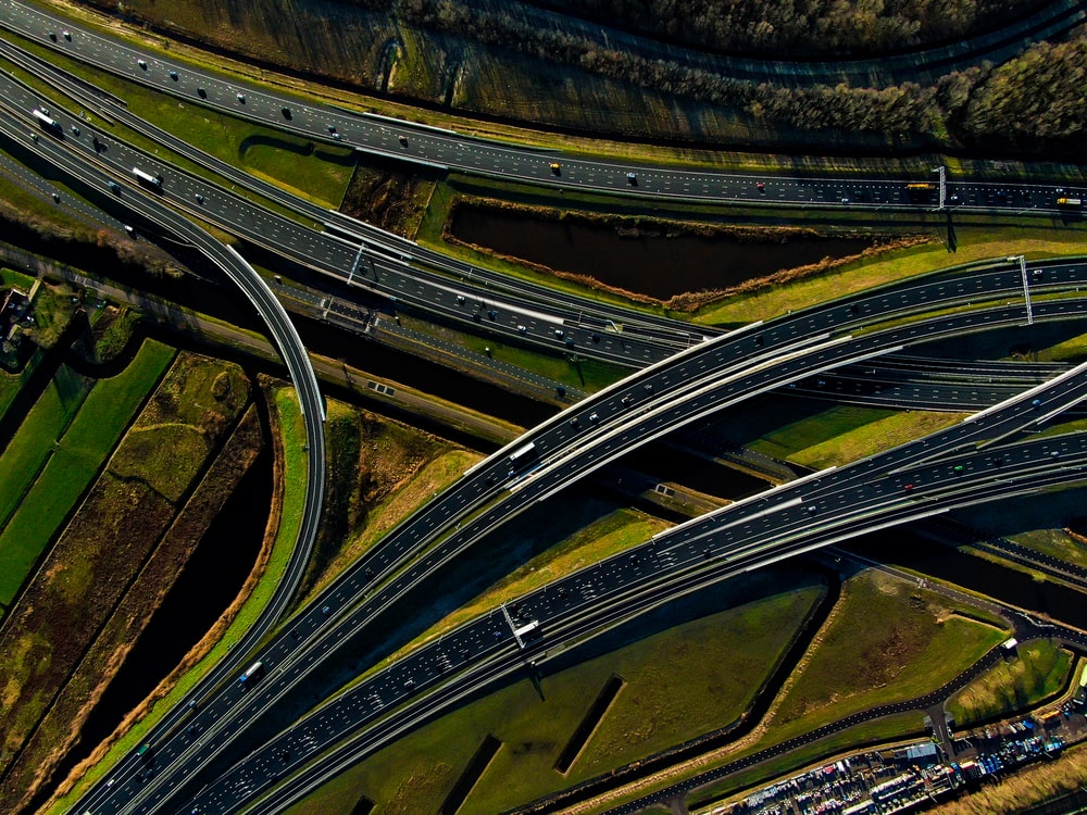 aerial view of vehicles crossing on roads