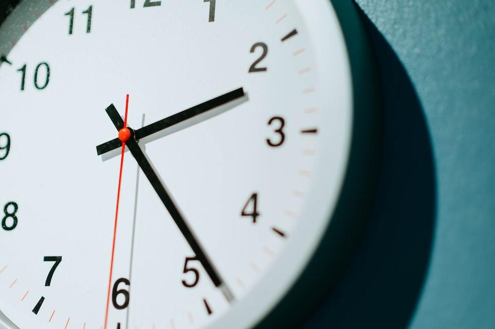 analog wall clock displaying 02:24