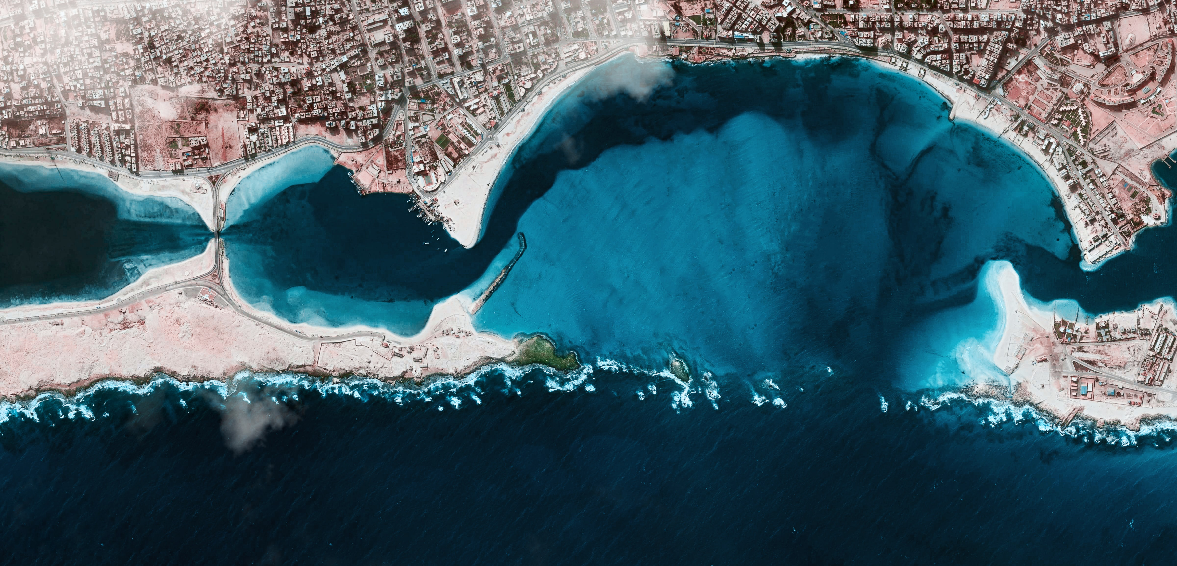 aerial photography of city near body of water