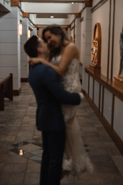 man carrying a woman at hallway