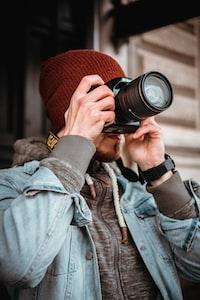 man taking picture during daytime