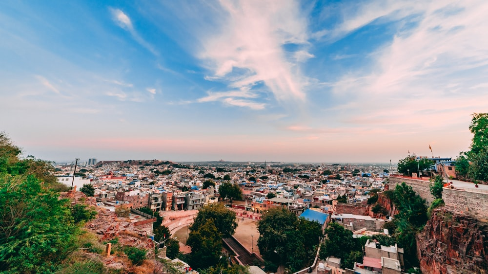 panoramic photography of houses and buildings under blue and white sky during daytime