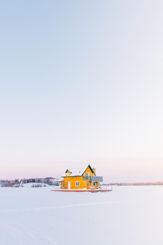 yellow cabin on snow field