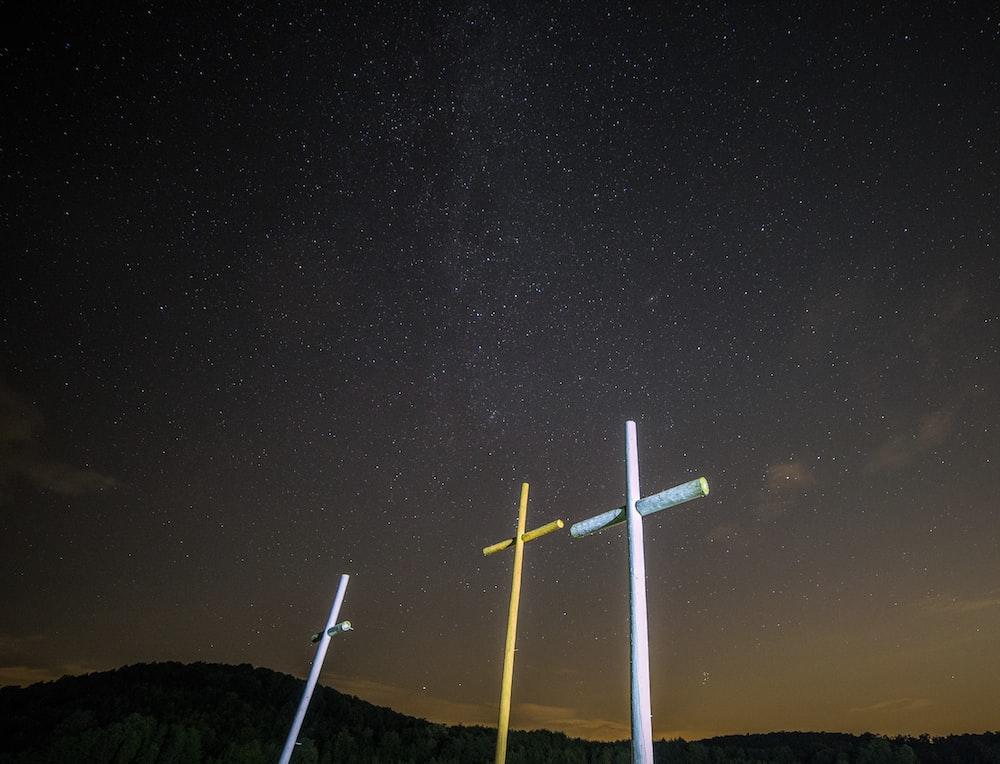 three yellow and white cross