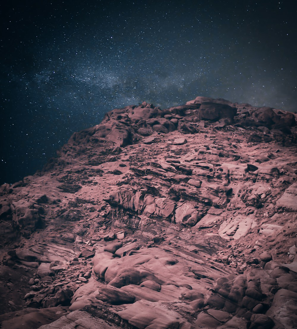 landscape photo of mountains under starry night