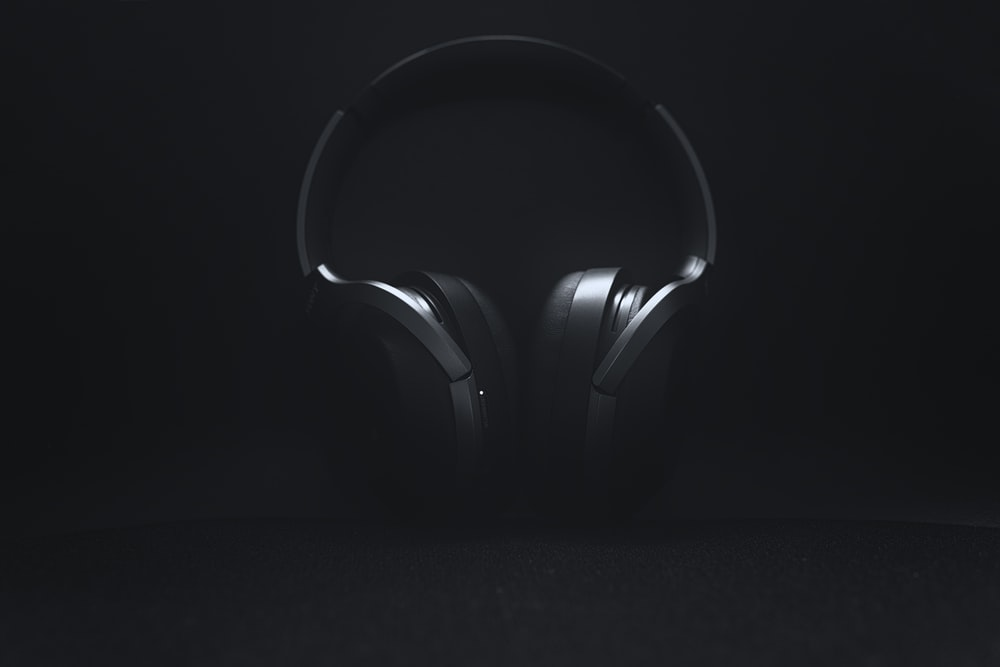 black and gray wireless headphones