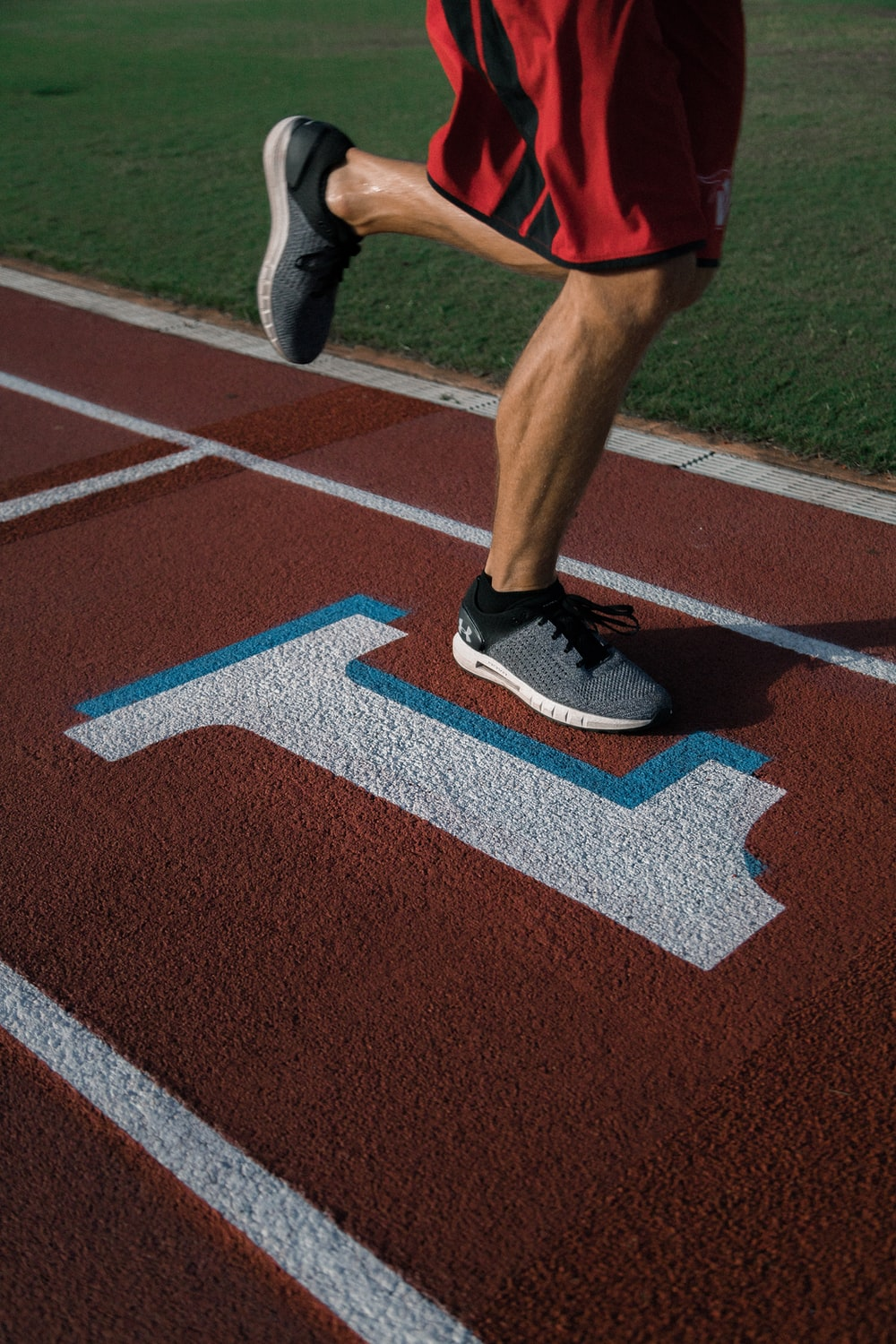person running on tracking field