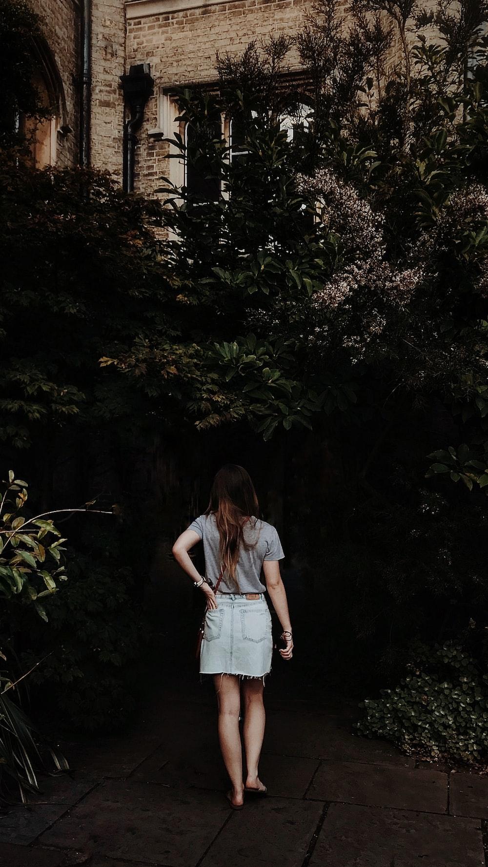 woman walking in flower garden