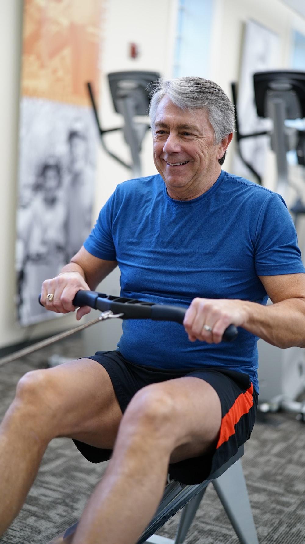 man exercising while smiling