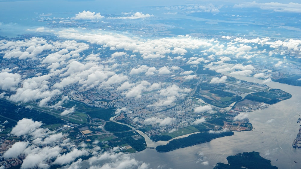 aerial view of land below the clouds