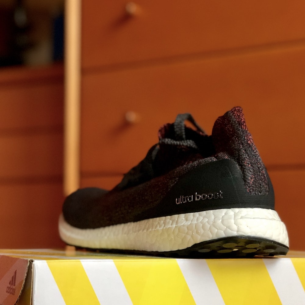 black Adidas Ultra Boost shoe on box