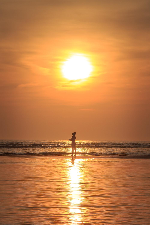 person standing near seashore