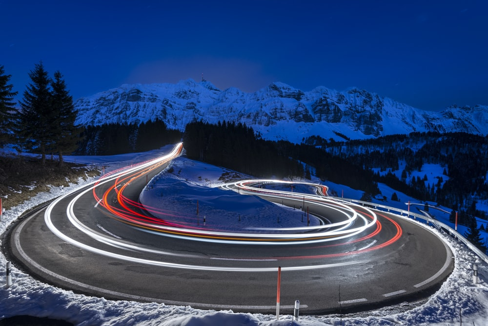 time-lapse photography of curve road