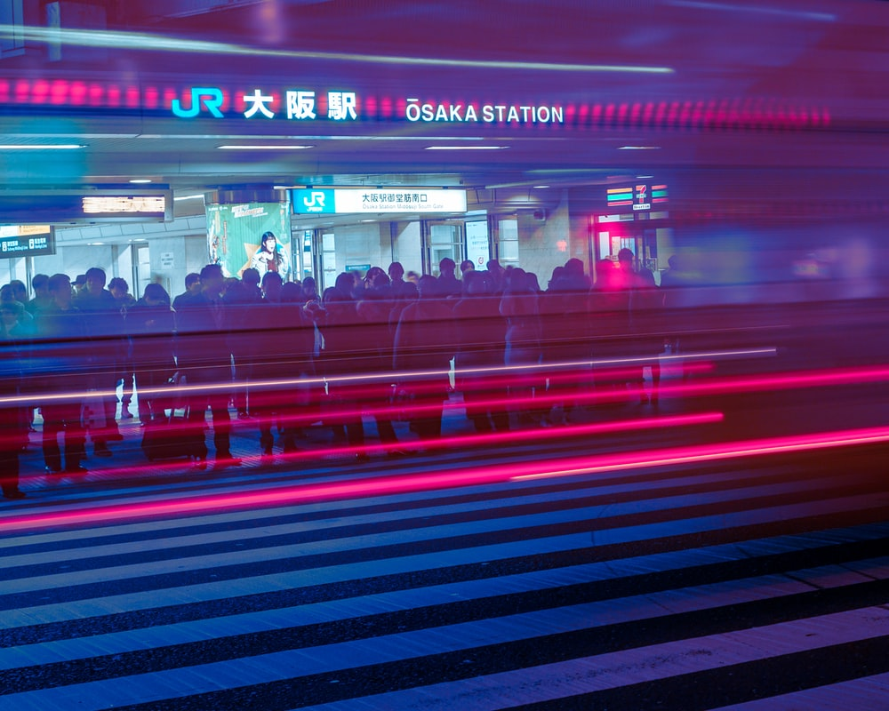 time lapse photography of people in subway