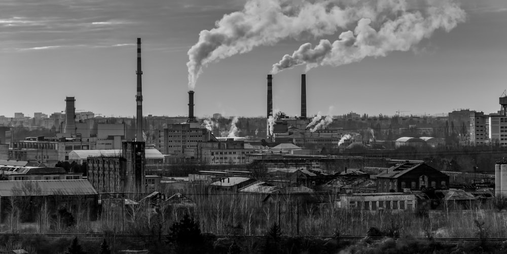 grayscale photography of factory