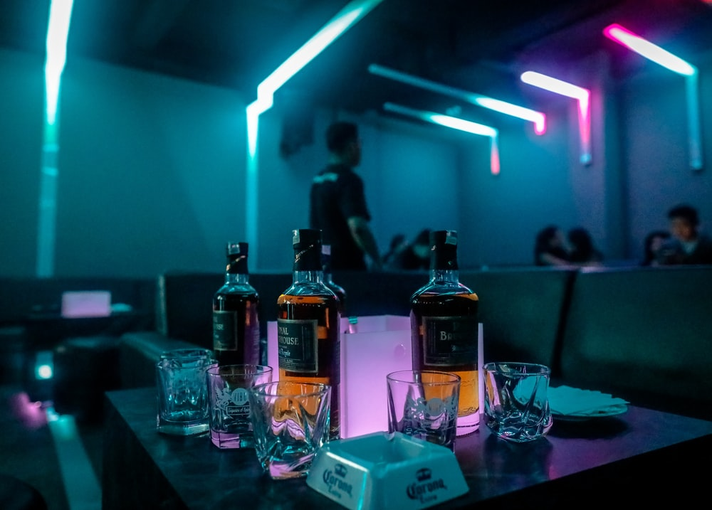 three liquor glass bottles