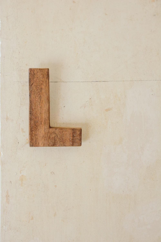 brown wooden L freestanding letter