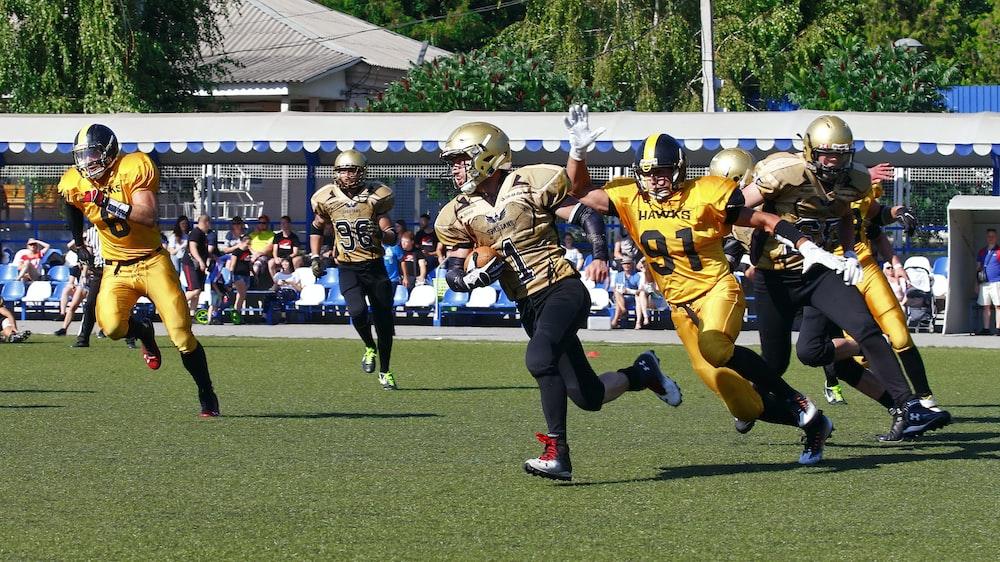 men playing football at stadium
