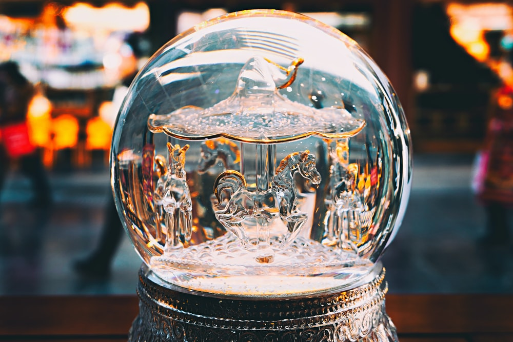 shallow focus photo of gray snow globe