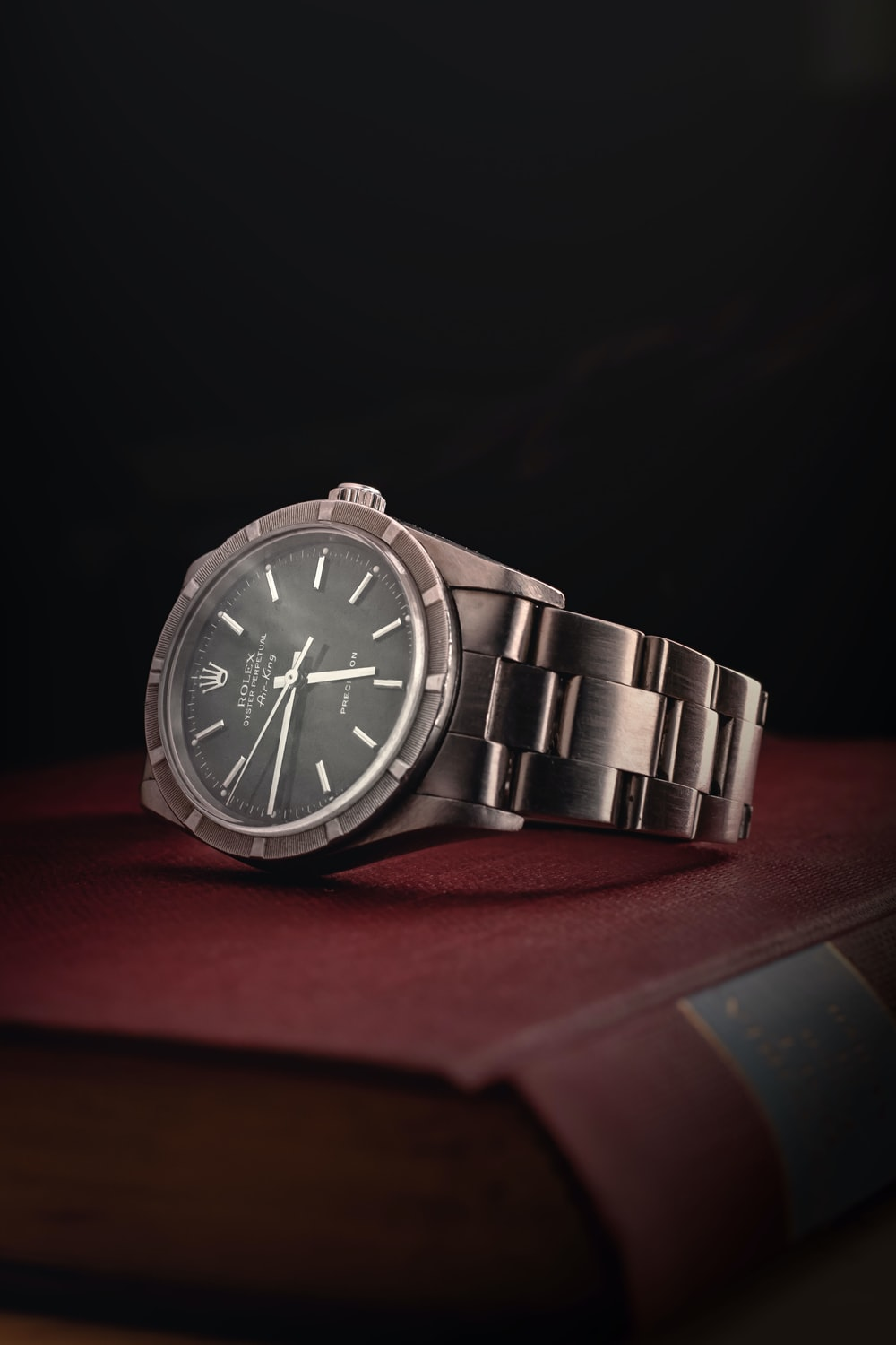round silver-colored Rolex analog watch with link band