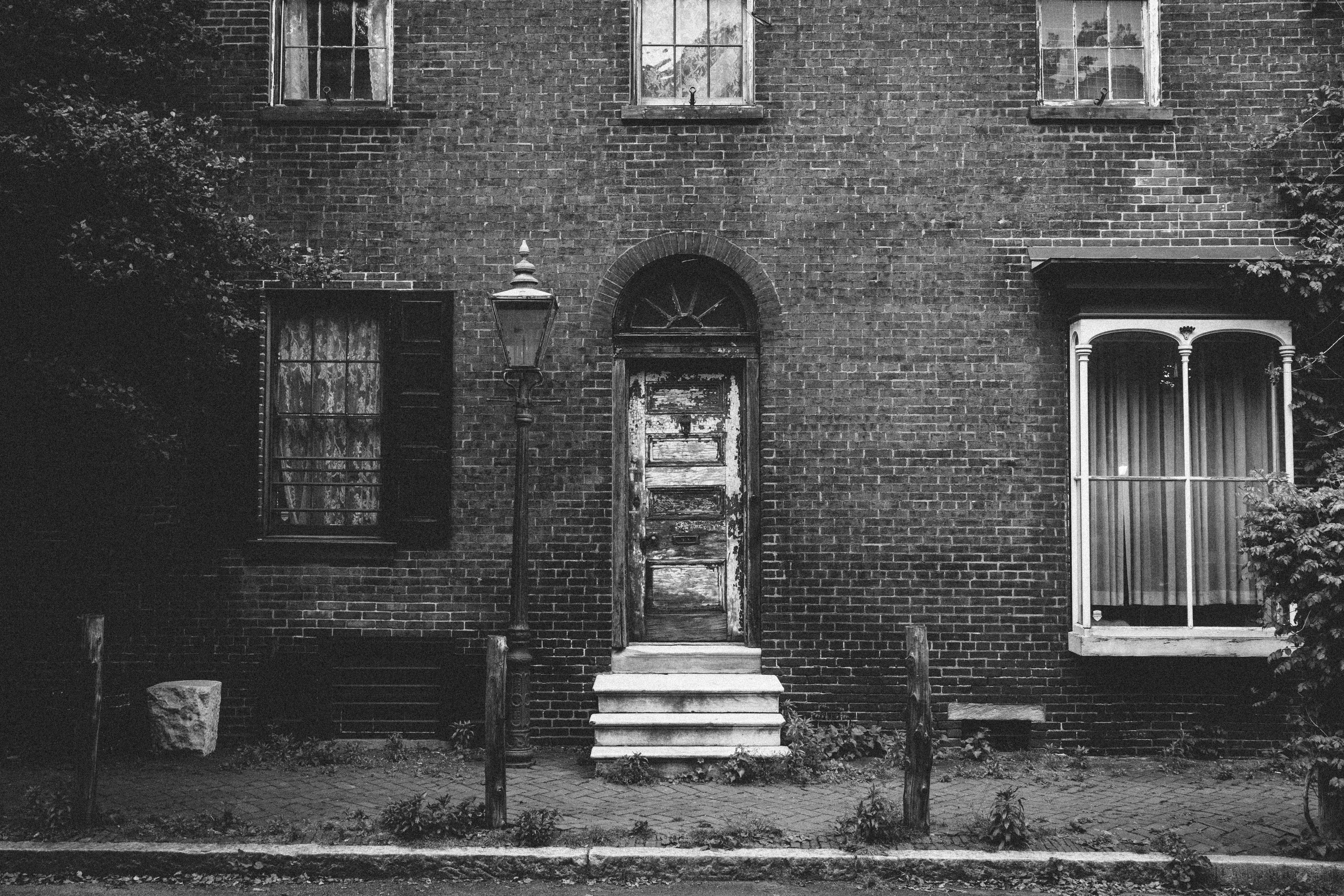 grayscale photo of house front