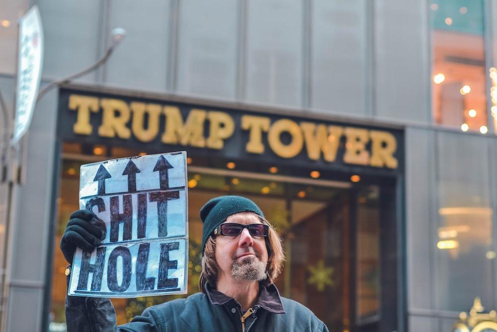 man standing near Trump Tower