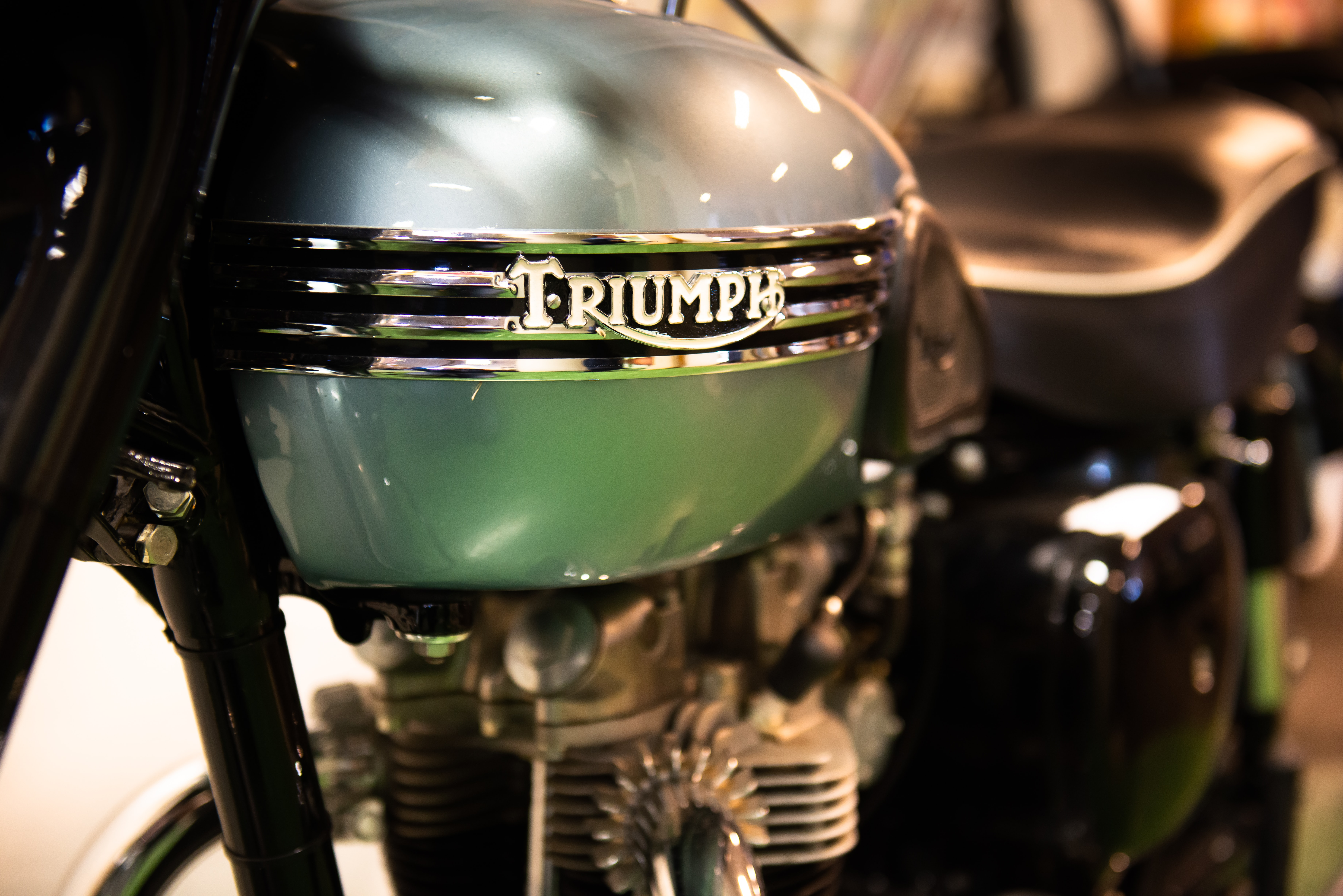 blue and black Triumph motorcycle