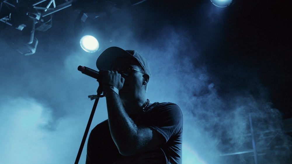 man singing on stage