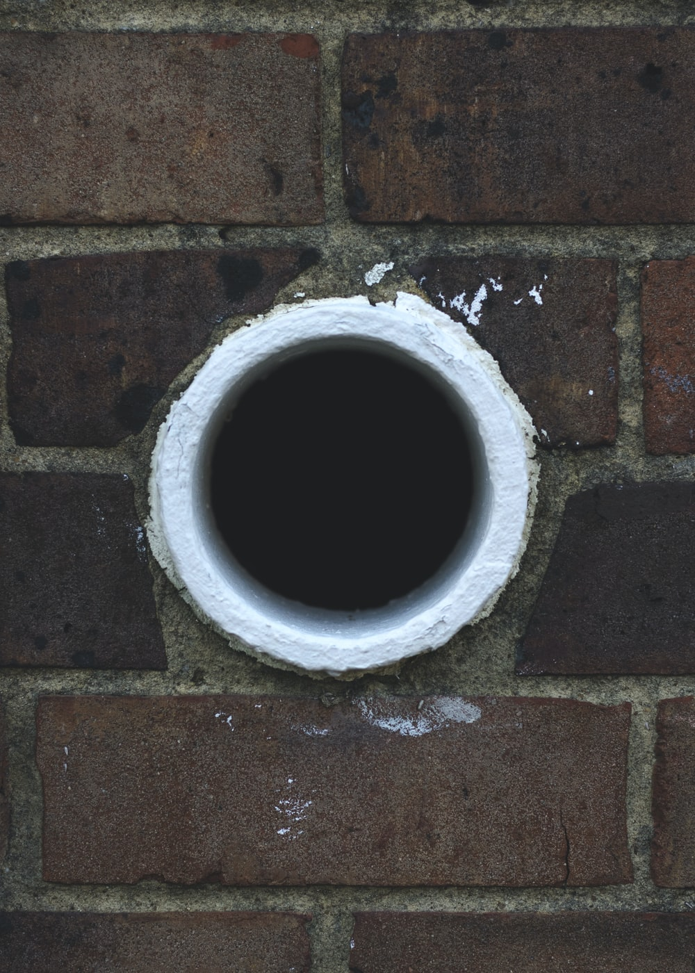 white hole in brick wall
